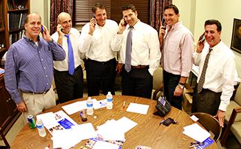 Glenn Gillen, Rocky Daigle, Bobby Comeaux, Scott Decker, Brian Illg, and Dante V. Maraldo help work the LEF Phone Drive.