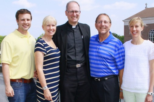 Fr. Raymond Fitzgerald, S.J. '76 with the Pontiff Family, from left, Nick '04, Terry, Wally, Sr., and Haley. The Pontiffs endowed Jesuit High School's first Full Education Fund.