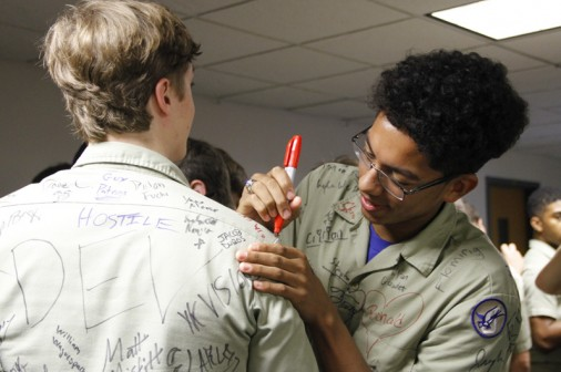 Gabriel Griffin signs his classmate's shirt.